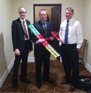 Left to right: Nick Saunders, Artyom Klochkov, and Nick Rains prepare for the presentation component of the competition.Photo credit:  WAZZU SkyCougs